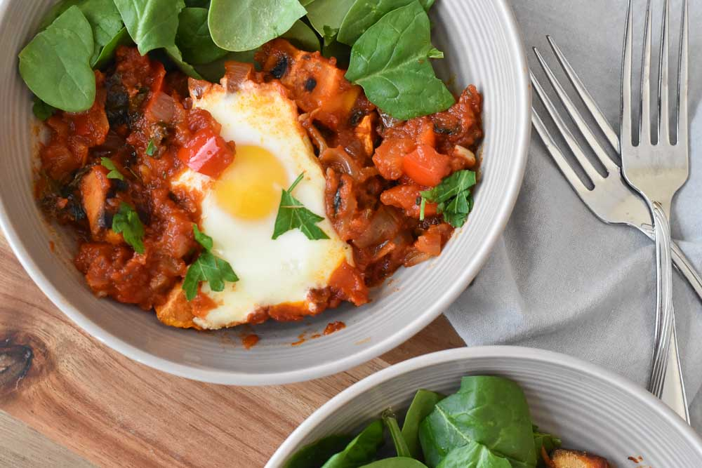 Whole30 Shakshuka in a bowl with spinach close up