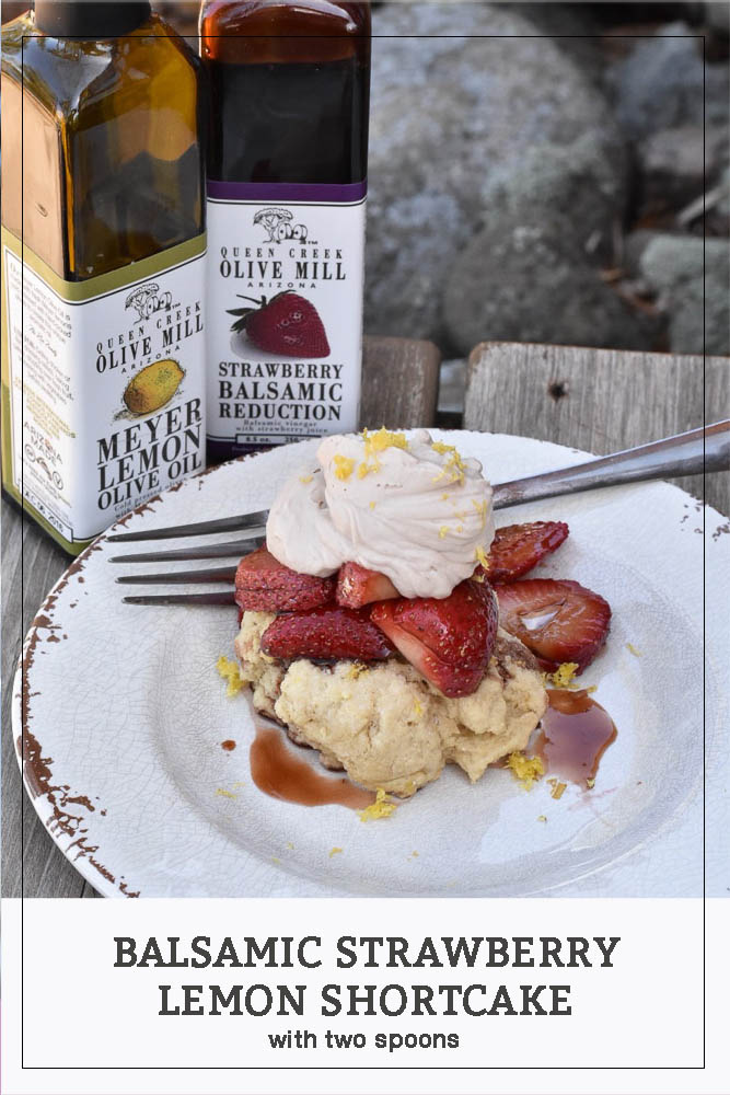 Balsamic Strawberry Lemon Shortcake on a plate with a fork. Queen Creek Olive Oil bottles in the background.