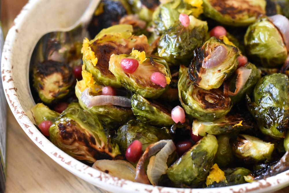 Close up of a bowl of Citrus Kissed Roasted Brussels Sprouts