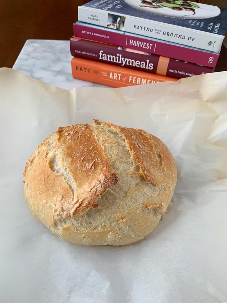 Dutch Oven Bread with cookbooks in the background