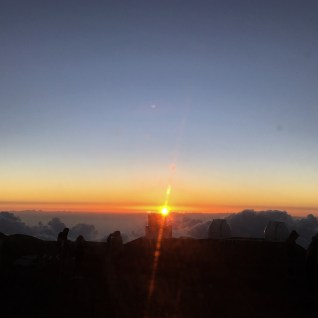 Watching the sunset from 14,000 feet above the Pacific Ocean. Not going to lie - it was weird.