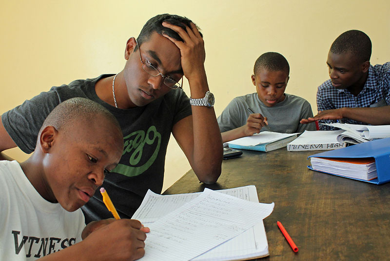 ASSISTANTS: Pergan Naicker (left) and Victor Sithole (right) from the Wits Volunteer Programme tutoring in Alexandra. Photo: Provided by Assist