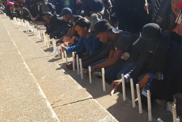 ROBALANG KA KGOTSO: Students light candles in memory of the Wits7 Photo: Nozipho Mpanza