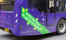 """A purple 17 bus showing the """"Another low carbon bio-gas bus for Reading"""" banner at the rear of the bus."""