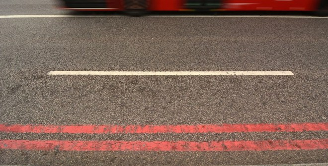A road with double red lines showing how red routes work