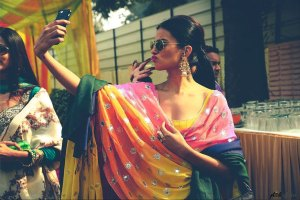 Free Makeup Apps   WEdding makeup trial help every Indian bride needs   Tips for Indian Brides   Indian bride in colourful suit clicking a pout selfie   Photo by - Plush Affairs Photography