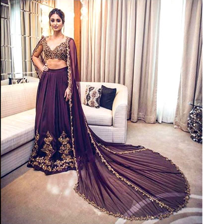 Trend Alert - Trains for the Indian Bride | Curated by Witty Vows | ileana D Cruze wears a stunning Ridhi Mehra llehenga with a cape train to die for at lakme fashion week 2016