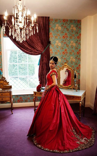 Trend Alert - Trains for the Indian Bride | Curated by Witty Vows | A red gown a sweeping train an indian bride