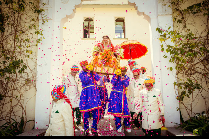 PICTURES THAT PROVE EVERY INDIAN BRIDE MUST GET A PICTURE WITH A FLOWER SHOWER | A bridal entry in style | Curated By Witty Vows