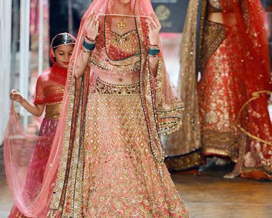 Creme to blush ombre lehenga with Zari work all over with accents of green and gold work overall | Tarun Tahiliani