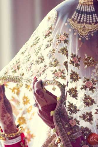 Love this ghunghat with work at the edges upping the sneak peak stakes for the Indian bride   Curated By Witty Vows