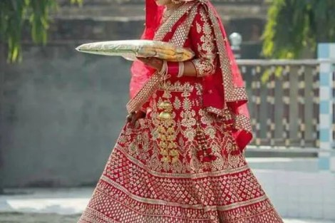 Red lehenga with gold gota patti work in tiers with different designs | Red blouse with gota work on sleeve| red net dupatta | Curated by Witty Vows