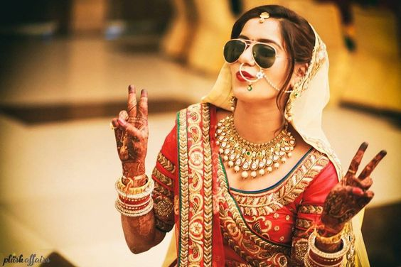 Sunglasses for an Indian Wedding | a must for the couple | Curated by witty vows | Selfie and photo of Indian bride with sunglasses | Hide the hangover