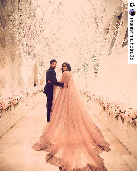 Trend Alert - Trains for the Indian Bride   Curated by Witty Vows   A beautiful gold gown for the cocktail with a long train   Manish malhotra with a long sweeping cape  New Indian wedding trends 2016