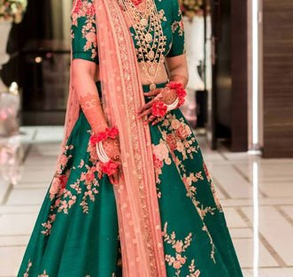 Green silk lehenga and close with beautiful pastel pink and blush embroidery paired with a peach net dupatta | Curated by Witty Vows