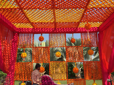 Magic with marigold | DIY decor ideas for the wedding house | using gainda on a budget | Floral canopy on porch for your guests to enter in style | Curated By Witty Vows