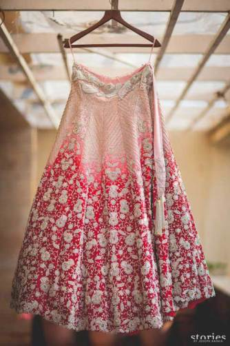 day wedding lehenga | Ombre blush and red lehenga with dull gold detailing for a day wedding | Photo by Joseph Radhik | curated buy witty vows
