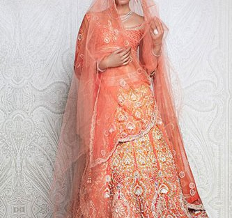 Day Wedding Lehenga Style | Peach yellow and gold lehenga with allover embroidery, red and dull gold crisscross gots border and peach net dupatta | Tarun Tahiliani | Curated by Witty Vows