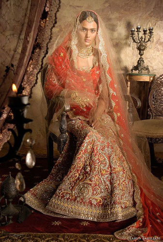 Day Wedding Lehenga Style | Vermillion red lehenga with yellow ochre, gold and silver accents and beautiful all over embroidery, gold net dupatta and second duppata in red with scalloped edges | Tarun Tahiliani | Curated by Witty Vows