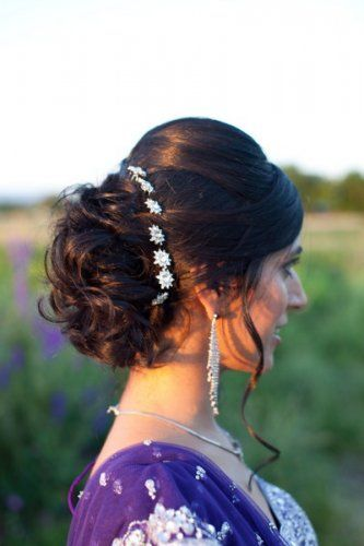Indian wedding hairstyles for Indian Brides |curl bun updo with silver flower pins for the Indian Bride | Photo Source - Kim Jones Photography | Curated by Witty Vows