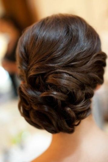Indian wedding hairstyles for Indian Brides| Elegant loose curl updo bun for the cocktail/wedding day for the Indian Bride | Curated by Witty Vows