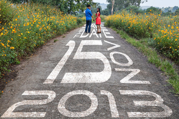 Couple photo shoot on the road with save the date written on the same   Curated by Witty Vows