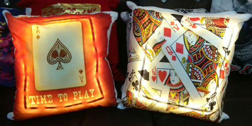Glowing led cushions with playing card prints for your diwali party | a great idea for the decor at your cards party for diwali at home