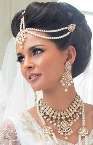Indian wedding hairstyles for Indian Brides | Elegant updo hairstyle for your wedding day | Image courtesy Montu Jewellery | Curated by Witty Vows