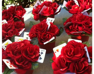 Red rose centrepieces with playing cards added in to give it height and some fun 'play' | ideas curated by witty vows for an amazing first diwali cards party for couples at home