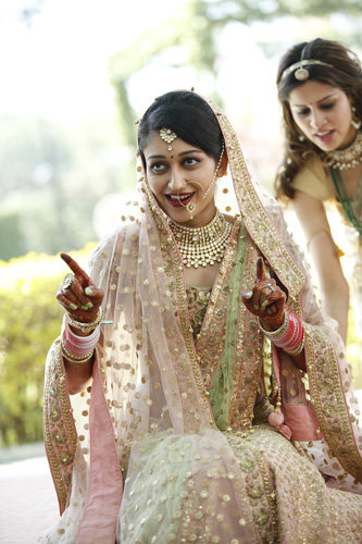 Anu weds Manu - a pretty day wedding in delhi| Pretty Indian Bride in an ombre ivory and blush peach lehenga with mint green accents and a mint green dupatta | pastel perfection | Bride wearing her kundan jewellery - maantika and nose ring | Bride doing bhangra | Double dupatta drape - blush on top and mint green underneath