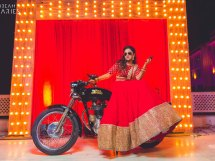 Candid bridal photo ideas | Bindaas brides | Witty Vows | photo by dream diaries | bride on a bike with a gun