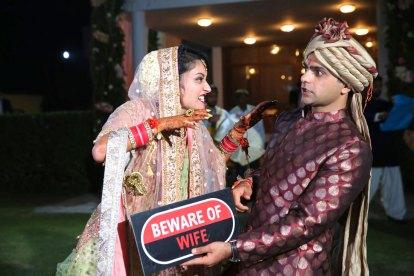 Anu weds Manu - a pretty day wedding in delhi | bride and groom super fun wedding shoot | beware of the wife props | fun couple