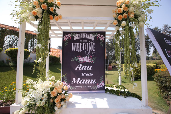 Anu weds Manu - a pretty day wedding in delhi| Pretty Indian Bride in an ombre ivory and blush peach lehenga with mint green accents and a mint green dupatta | pastel perfection | flower decoration and chalk board sign with couples names - Anu weds Manu