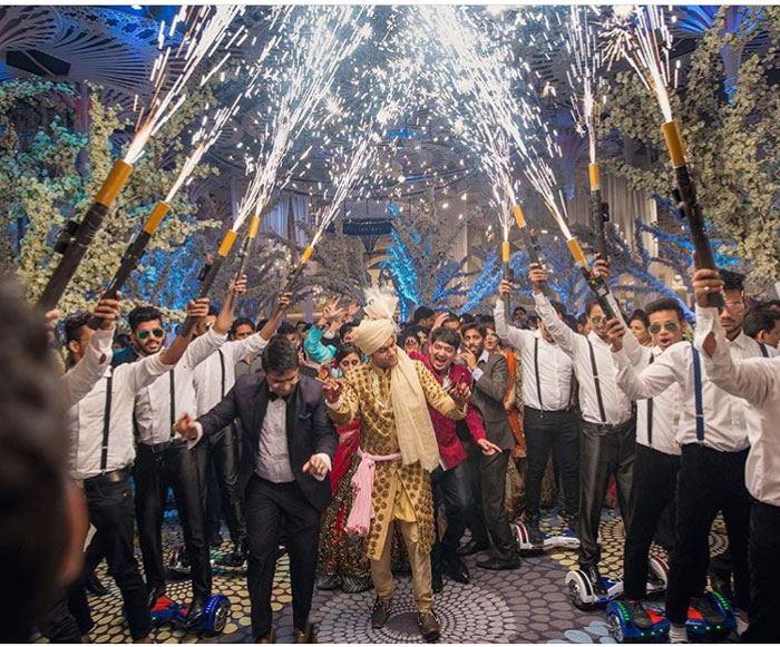 Indian groom entry ideas | Groom enters with his batsmen with cold pyro shots and hand held gerbs | Curated by witty vows