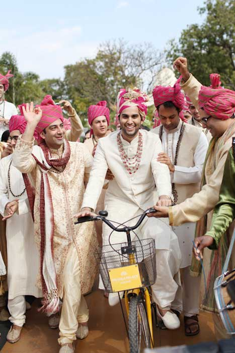 Indian groom entry ideas | Groom enters on a cycle with friends | Curated by witty vows