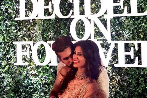 Indian Wedding Ideas from Suyyash and Kishwer's Wedding Reception | Kishtwar in a peach & silver lehenga and suyyash in a white tux | we decide on forever backdrop with letters white on green grass backdrop
