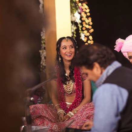 New Indian wedding ideas from VJ Yudi and Aditis Pretty Wedding | Yudhisthar and aditi laughing during the ceremony