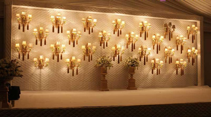Sufi Night | Sangeet decor ideas | Free Sangeet Theme | decor ideas for sufi sangeet | Designed by Akhil Paul | Ivory stage with golden lamps decor for sangeet night