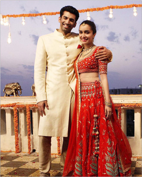 Shraddha Kapoor in a red vermillion orange Anita Dongre lehengas with gold gota Patti and large embroidered motifs for Ok Jaanu paired with a delicate gold waist belt | Bollywood fashion | Wedding Lehengas | bollywood lehenga | designer lehenga