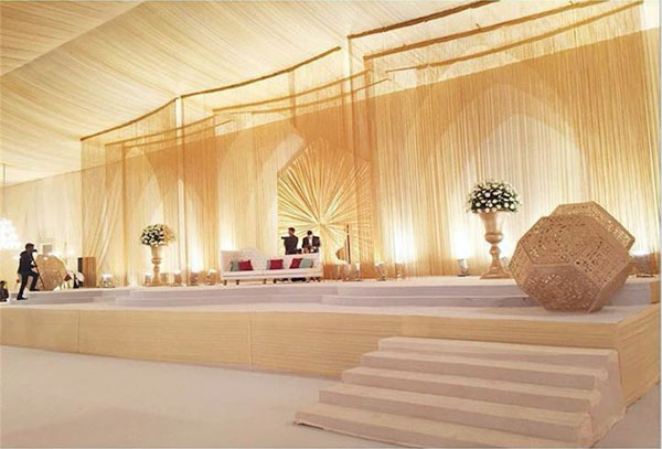 Sufi Night | Sangeet decor ideas | Free Sangeet Theme | decor ideas for sufi sangeet | Designed By - Pomegranate Design | Gold thread curtains for Indian Sangeet Stage | Ivory and gold stage backdrop for Indian Wedding