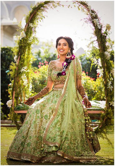 Mehndi jhoola and innovative mehndi decor ideas | beautiful mehndi swing bridal seat idea Cane garden swing decorated in pastel flowers and greens Photo by - The Wedding Story