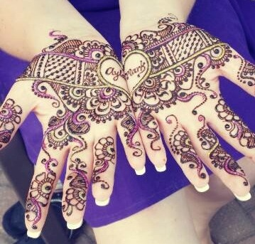 Bridal Mehndi ideas | new way to write the groom's name on the bride's hand | groom's name in two halves making a heart when joined | New trending Mehndi designs