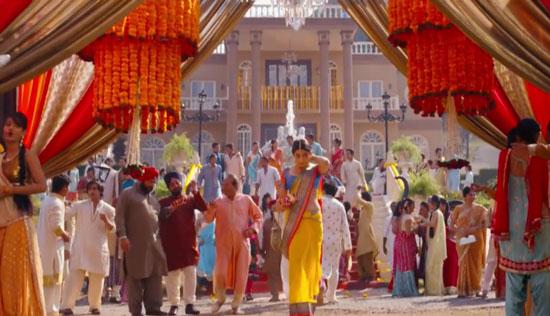decor ideas from bollywood film 2 states   bollywood wedding   fun diy mehndi decor ideas   Iski Uski   colourful decor for Indian mehndi   marigold flower chandelier with pom pom ends and flower tassels