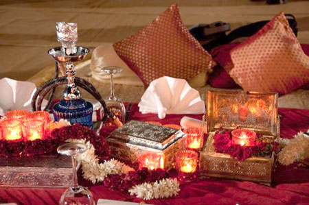 sufi style accents | surahis |boxes | gajras | hookah | cushions in orange and gold