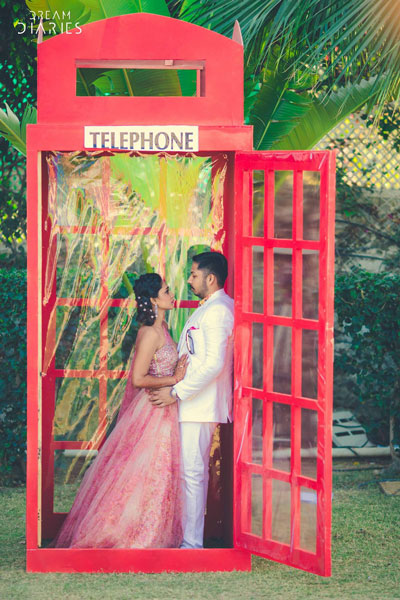 Red telephone booth photo op for indian wedding| couple photoshoot ideas | Indian bride in pretty pink gown | Indian wedding photo booth ideas | Photo Op ideas | fun wedding photos | Dream Diaries