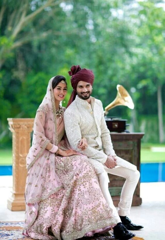 Coordinated outfits, Tips for Couple outfits | Bride Meera ragout wears a pink lehenga and groom shahid Kapoor wearing a deep Burgundy matching saafa