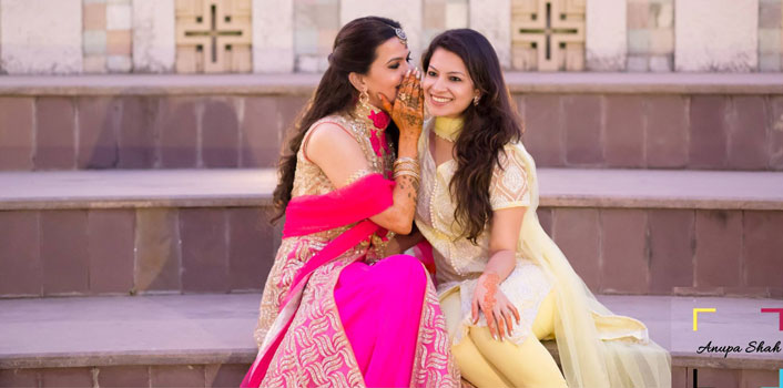 Indian bridesmaids duties   Bride's friends   BFF photos from Indian wedding   Bride gossiping with friend   whispering in her ear   Anupa Shah Photography