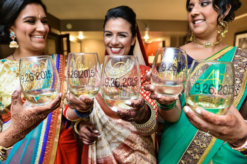 Indian bridesmaids duties   Bride's friends   BFF photos from Indian wedding   Indian bride with her bridesmaids toasting before the wedding in customised glasses wine   grey card photography