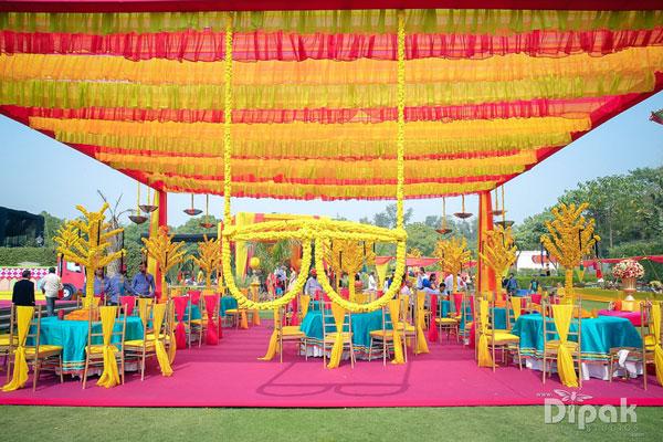 Mehndi decor with marigold flowers | flower sunglasses photo op | Amrit and sukriti's Mehndi