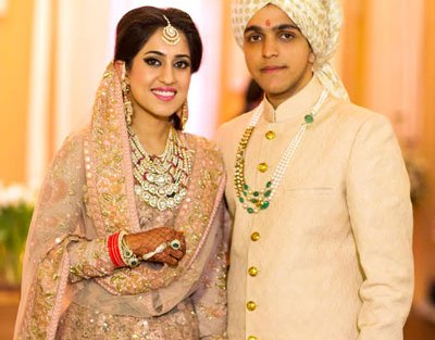 Ridhi Mehra wedding | Ridhi and akshay's Valentine's Day wedding | bride in pale pink Sabyasachi lehenga with Kundan jewellery and groom in creme Rohit Gandhi sherwani